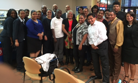 Group photo of BronxWorks program participants, facilitators, and Popular Community Bank staff.